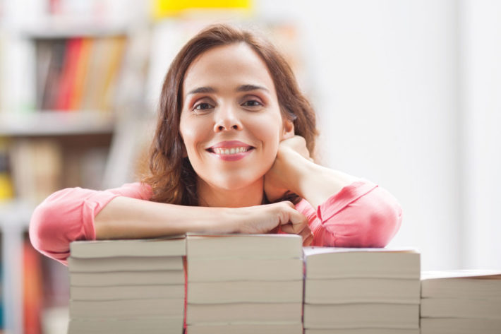Bookstore Worker With Books